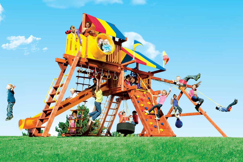 Rainbow Super Turbo Castle Pkg IV Cover Shot Wooden Swing Set